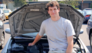 Steering his future — Student entrepreneur Greg Buscher turned his hobby into a business, offering car care to students and residents around the Lynchburg  area. Photo credit: Amy Marquez