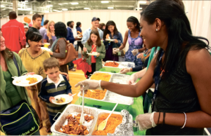 Sampling the world — International students and volunteers served hot dishes to faculty and staff from their native countries at the annual Taste of the Nations. Photo credit: Ruth Bibby