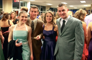 Dressed to the nines — Students Phoebe and Robby Waller, Rebecca Garrett and Luke Riddell (left to right) came out in their best for the Junior/Senior Gala Saturday in Williams Stadium. Photo credit: Ruth Bibby