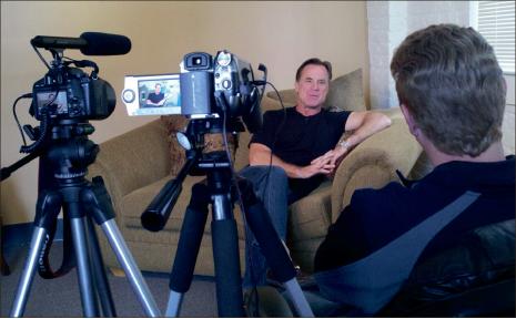 Innovative faith — IFR Vice-President Brandon Pickett interviews Mark Koch, manager for Nationwide Series NASCAR driver Blake Koch. Photo provided