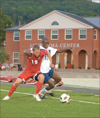 Struggle — Freshman forward Blessing Tahuona fights for control of the ball. Photo Credit: Ruth Bibby