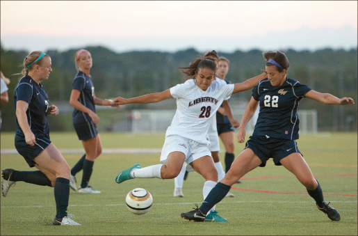 Control — Midfielder Hannah Meyers (28) looks to cross the ball in an attempt to score. Liberty won 1-0. Photo credit: Jake Mitchell