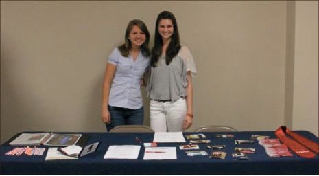 PRSSA — Executive board members of PRSSA Kristen Gorstuch and Victoria Petrocelli pose at the club's table. Photo provided