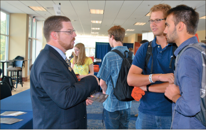 Profession — Williams Stadium hosted the School of Business meet and greet on the Club Level. Photo credit: Jill Springer