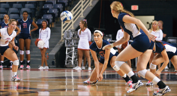 Digging in — Lillie Happel (12) had seven digs in the Lady Flames 3-0 victory against Winthrop Saturday, Oct. 20. Photo credit: Ruth Bibby