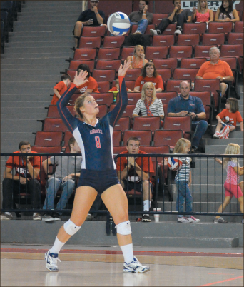 Service — Libero Gabrielle Shipe began a rally in the match against Campbell. Photo credit: Kate Welch