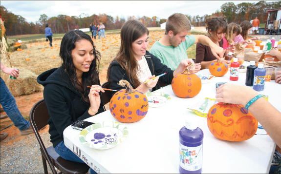 Pumpkin patch — Liberty students enjoy picking and painting pumpkins at the second annual Fall Festival held at the Liberty University Equestrian Center. Photo credit: Ruth Bibby