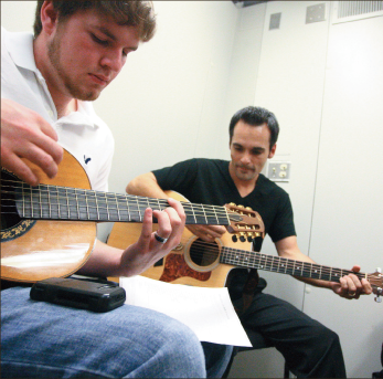 Worship —Worship majors Tyler Daniels (left)  and Sonny Kingsbury (right) practice their guitars. Photo credit: Ruth Bibby