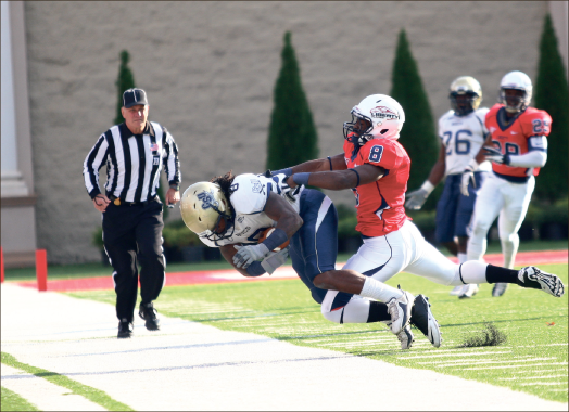 Overwhelmed — Liberty defensive back Brent Vinson forces Charleston Southern receiver Chase Jones out of bounds. Photo credit: Ruth Bibby