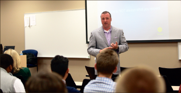 Speaker — Dean Parker, CEO of Callis Communications, addresses business students. Photo credit: Ruth Bibby