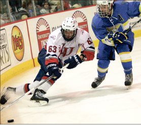 Speed — Bram Erickson makes a play on the puck. Photo credit: Ruth Bibby