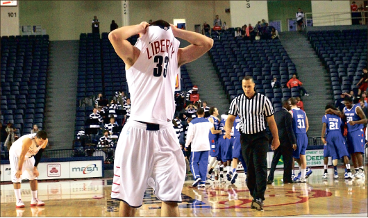 Woulda, coulda, shoulda — A dejected John Caleb Sanders, 33, walks off the court after the one-point loss Sunday. Photo credit: Ruth Bibby