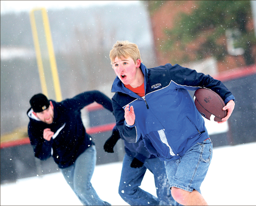 Snow-bowl — Liberty students gathered for a cold game of football following the snowstorm Friday, Jan. 25. Photo credit: Ruth Bibby