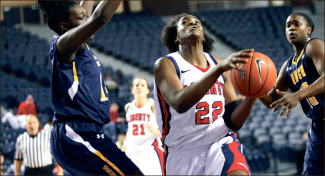 Layin' it in — Tolu Omotola has 22 points,12 rebounds against High Point. Photo credit: Ruth Bibby
