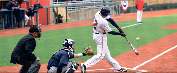 Crack of the bat — The Flames introduced their nearly-completed ballpark to the public, Saturday Feb. 23. More than 2,500 turned out to see the Flames 4-1 victory. Photo credit: Ruth Bibby