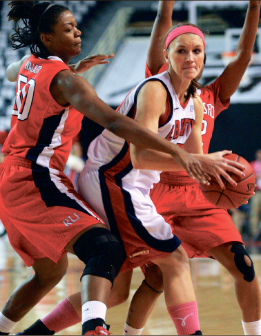 Struggle —  Redshirt senior Brittany Campbell looks to pass out of a trap. Photo credit: Ruth Bibby
