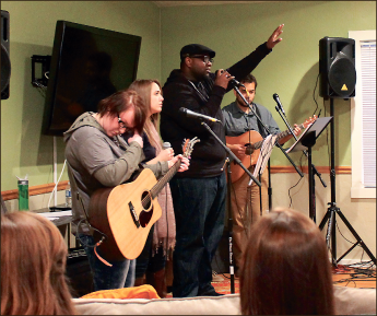 Performing — Commuter Services hosts their first night of worship this year. Photo credit: Jessica Jordan