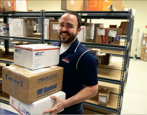 You've got mail— Will Luper finds joy in the little things as he interacts with students over packages. Photo credit: Chris Mabes