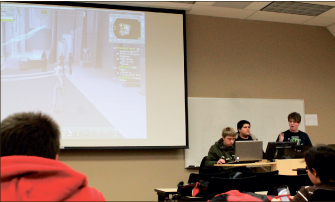 Gaming — Members play and discuss games during Thursday night meetings. Photo credit: Jenny House
