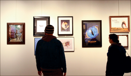 Admiration — Liberty students look at some of the artwork displayed in the SADA exhibit. Photo credit: Ruth Bibby