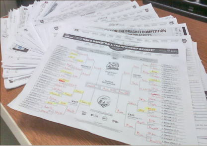 Brackets — No matter how frustrated basketball fans get year after year, filling out the March Madness brackets is a tradition for almost everyone. Photo credit: Andrew Woolfolk