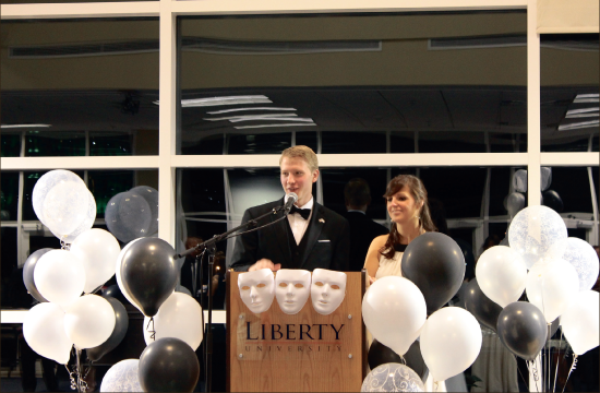 Dressed up — Chad Atchison and Chelsea Patterson address the juniors and seniors at Williams Stadium. Photo credit: Ruth Bibby