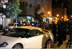 night — Actor Andrew Cheney (Jason Shaw) gets in a vehicle on Main Street in Downtown Lynchburg.  Photo provided