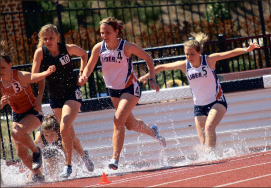among the pack — Liberty runners Jessica Gass (left) and Caroline Parris (right)  ran in the 3000-meter steeplechase. Photo credit: Ruth Bibby