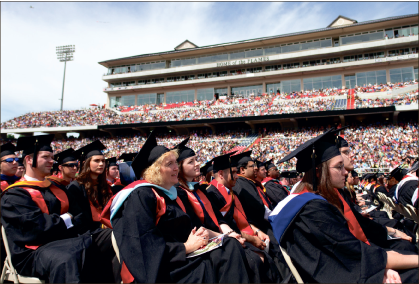 TURNING TASSELS — Students at last year's commencement are recognized for their success. Photo credit: Ruth Bibby