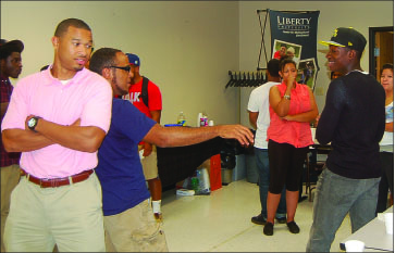 fellowship — Students enjoy playing a game at an Impact meeting.  Photo provided