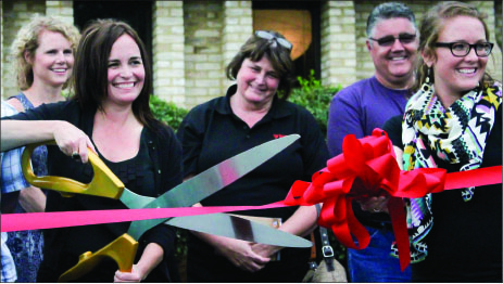 Beginning— CEO Melinda Wilson cuts the ribbon to celebrate the opening of a new facility. Photo credit: Angie Pacitti