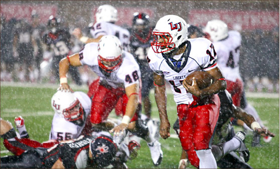messy conditions — Kendall Couamin returns a squib kick in the third quarter as the rain intensifies at Robins Stadium. Photo credit: Ruth Bibby
