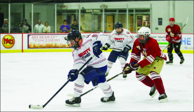 smooth transition — Freshman defenseman Ryan Sidun handles the puck against Elon. Photo credit: Ruth Bibby