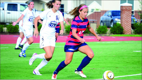 cruise control —  Midfielder Madison Kauzlarich gains possession of the ball. Photo credit: Macklyn Mosley