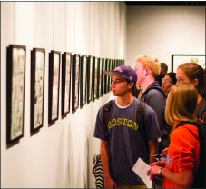 on display — Aspiring artists and comic fans alike gathered Thursday, Sept. 19, to admire the work of experienced artist Lee Weeks. Photo credit: Kyle Erikson