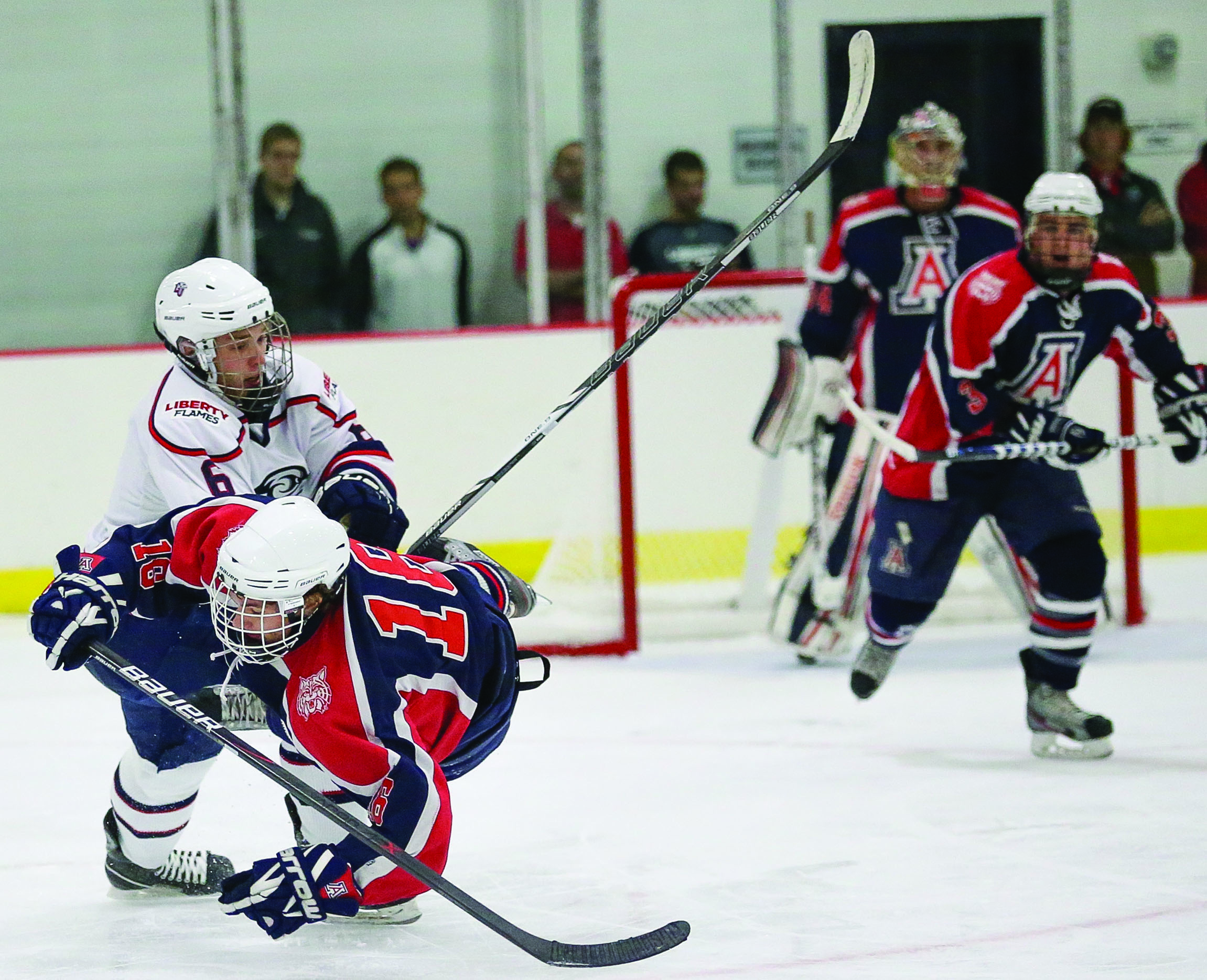 BIG HITS — Liberty rebounded to thrash Arizona in game two. Photo credit: Ruth Bibby