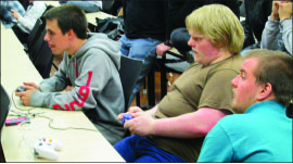 Challenge — Students participate in a gaming tournament. Photo credit: Mark Tait