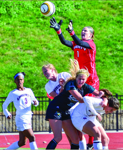 JUMP BALL — Lady Flames goalkeeper Holly Van Noord tries to catch a ball between multiple Lady Flames defenders and a Lady Chanticleer. Photo credit: Steven Abbott