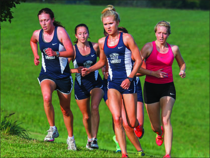 BREAKING A SWEAT — The women's team looks to mature and improve as the season progresses. Photo credit: Joel Coleman