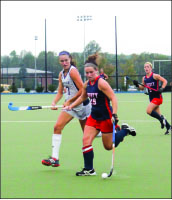 ON THE RUN — Natalie Barr (29) scored three Lady Flames goals. Photo credit: Angie Pacitti