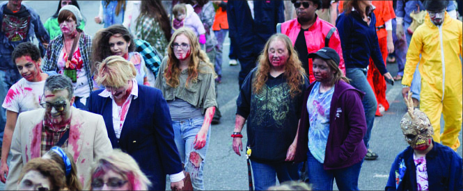 Slow and Steady —The Zombie Walk brought a large crowd and also featured a brain-eating contest, costume prizes, makeup artists and more. Photo credit: Leah Stauffer