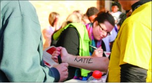 Motivation — Participants have the option of having a victim's name written on them. Photo credit: Sara Warrender