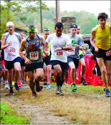 Runners participate in the Deep Hollow 5k race