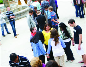 At the pole — Students engaged in a nationally recognized day.