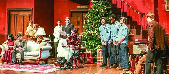comedy — Theater-goers embrace the comedy of differing personalities when an unexpected Christmas guest shows up at the door of an Ohio family in the latest play. Photo credit: Ruth Bibby