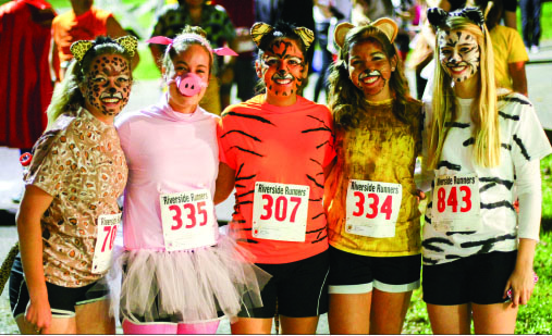 Masks — Students show off their costumes for the Halloween Fun Run at Camp Hydaway. Photo credit: Courtney Russo