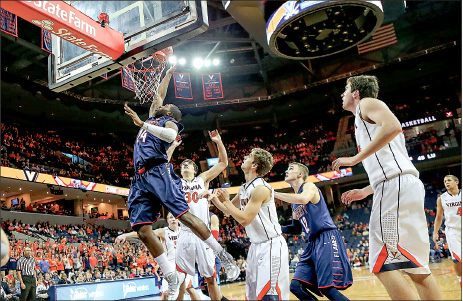 paint presence — Antwan Burrus tips in a missed shot late in the second half against Virginia. Photo credit: Ruth Bibby