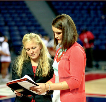 mentor — Brittany Campbell (right) goes over a game plan. Photo credit Ruth Bibby