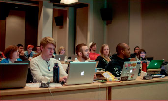 EDUCATION— Caleb Fogleman (far left) and other students learn principles of film production in a classroom setting with state-of-the-art production equipment. Photo credit: Dale Courty II