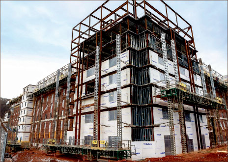 A new five-story dormitory is scheduled to open fall 2014. Photo credit: Courtney Russo